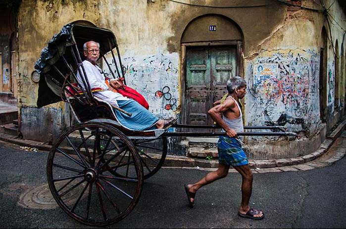 A great way to see the city is by riding in a rickshaw. Photo by Saumalya Ghosh