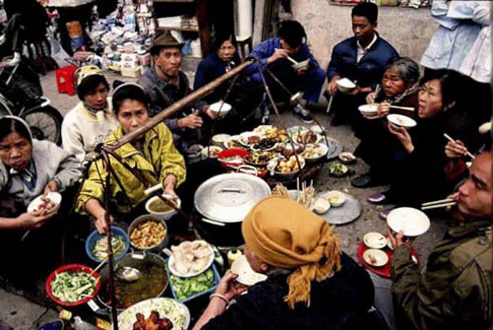 Lunch break for street food sellers in Hanoi, Vietnam. Photo by Hanoi Street Foods