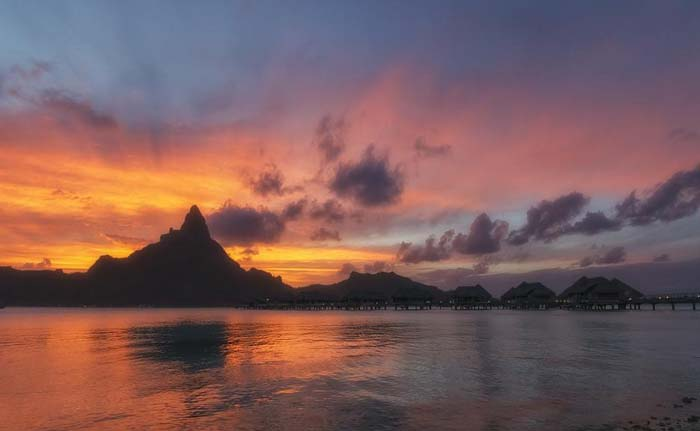 Another beautiful sunset over Mt. Otemanu. Photo by Jave Foto