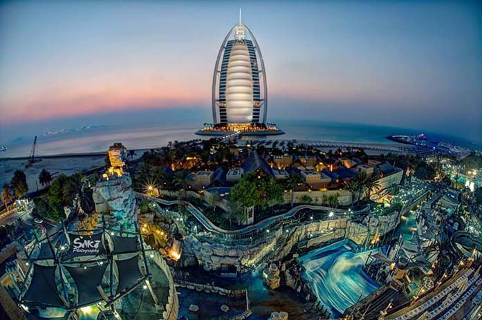Burj Al Arab glowing at sunset. Photo by Sikander Naveed, Pinterest