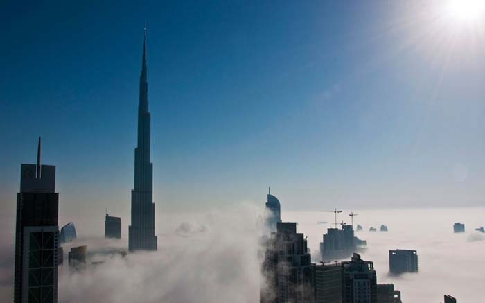 Burj Tower looks like a spike through the sky. Photo by Shiva Menon, Pinterest