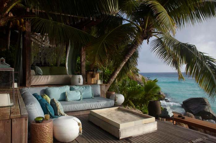Chill out on comfy lounges by the sea in North Island, Seychelles. Photo by Idee Per Viaggiare, flickr