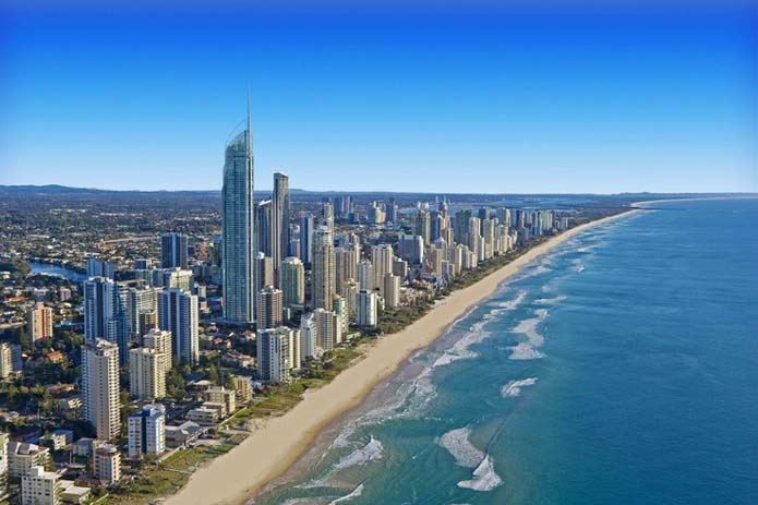 Long stretch of beautiful beach Surfers Paradise along the Gold Coast, in Australia. Photo by Sandy Robertson, Pinterest