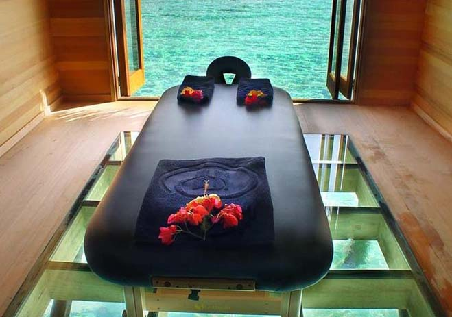 Massage bed with a beautiful view of the sea through the floor. Photo by Teri Farley, Pinterest
