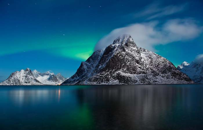 Northern Lights over Olstind in the Lofoten Islands. Photo by Cody Duncan