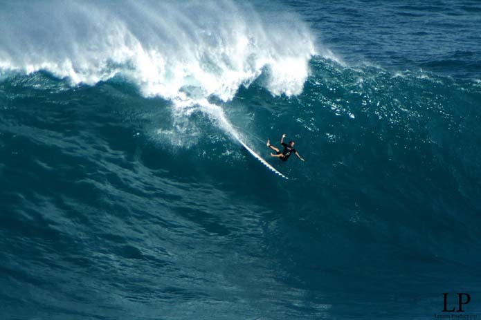 Surfer about to get dumped at big wave spot in Peahi, Hawaii. Photo by Aaron Lynton, flickr