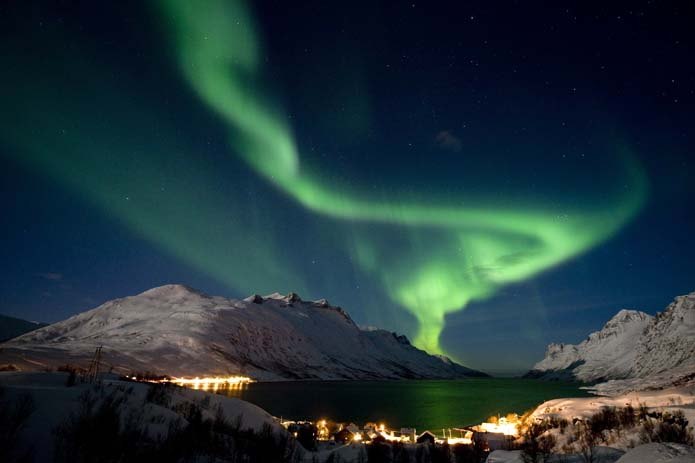 The aurora borealis, or northern lights, are seen on the sky above the village of Ersfjordbotn near Tromso in northern Norway