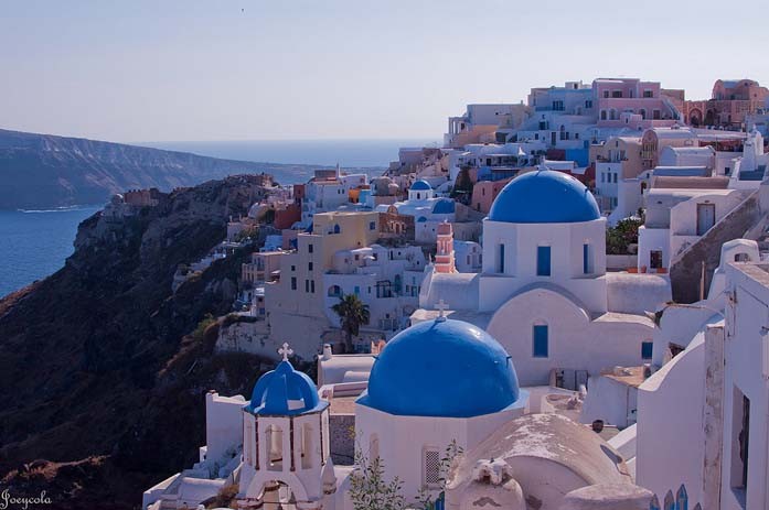 Santorini is famous for its blue and white buildings that scatter the hillside. Photo by Mints Time, flickr