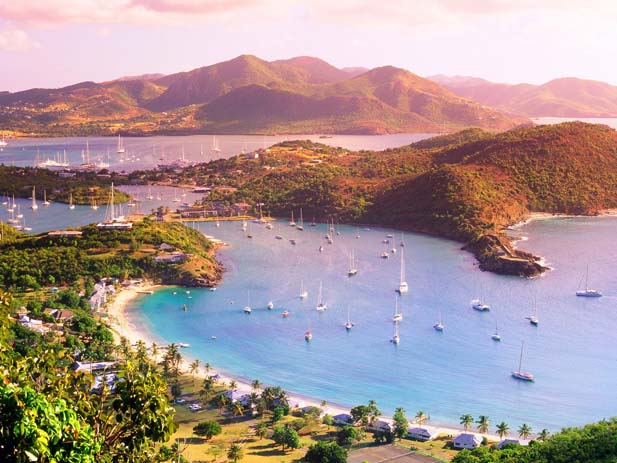 Sunset over Antigua Leeward Islands. Photo by Wallpaper Web