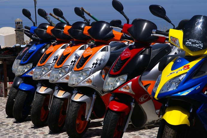 Scooters can be hired to travel around the island from a number of companies and street sellers. Photo by palindrome6996, flickr