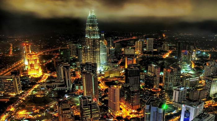 Kuala Lumpur at night. Photo by 1hdwallpaper
