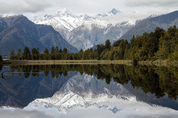 Lake Matheson gives a mirrored view of the Fox Glacier on the West Coast. Photo by Geee Kay, flickr