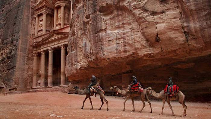 Camels at the main treasury in Petra, Jordan. Photo by Getty Images
