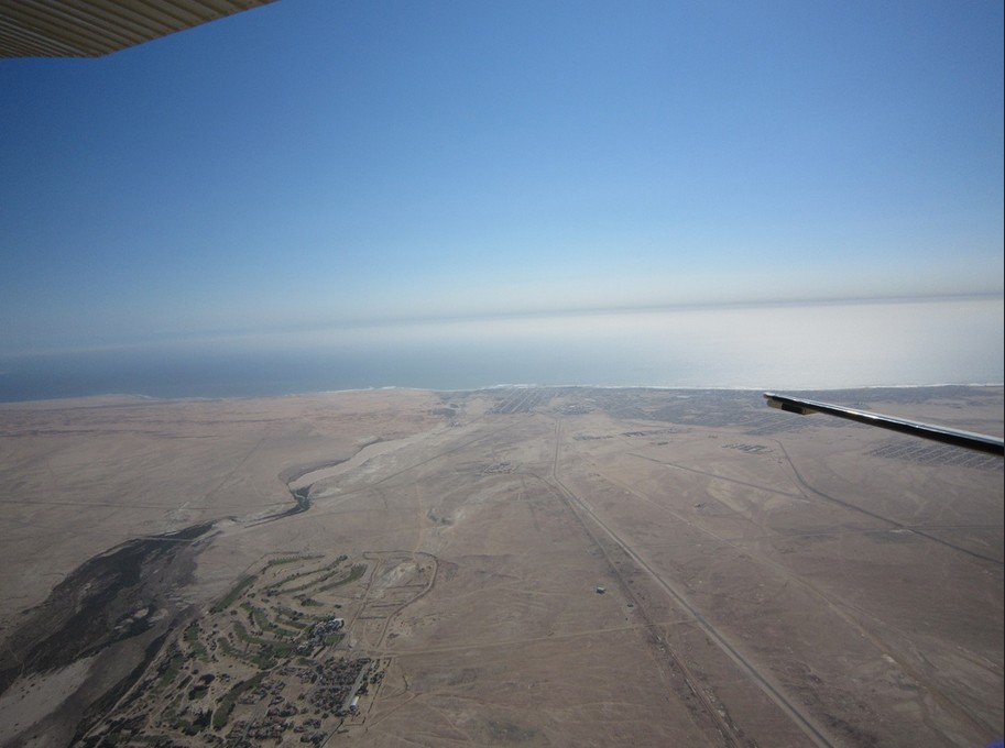 7 of best places to skydive around the world: Swakopmund from the planes edge, Photo by Carola Bieniek, flickr