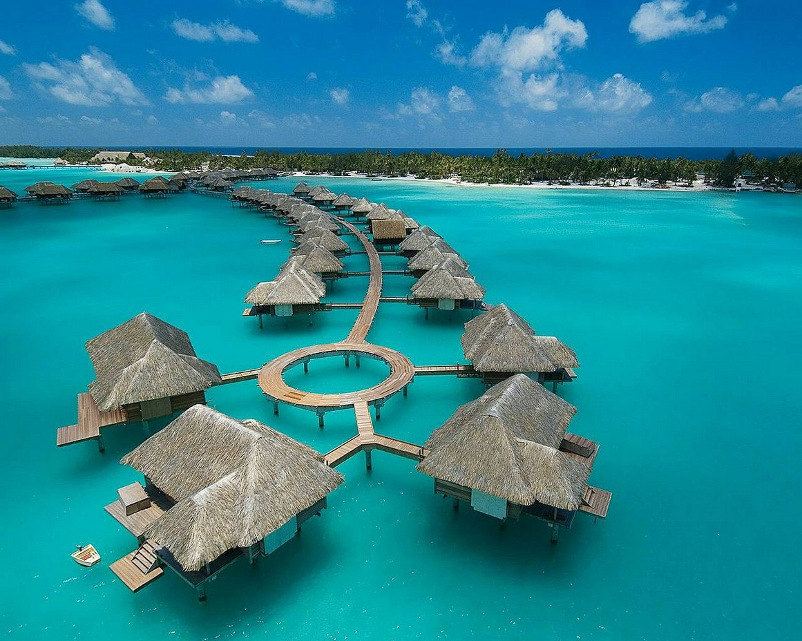 Where to find the clearest water on earth: Ocean huts on Bora Bora, Photo by Bonica.co, Google Images