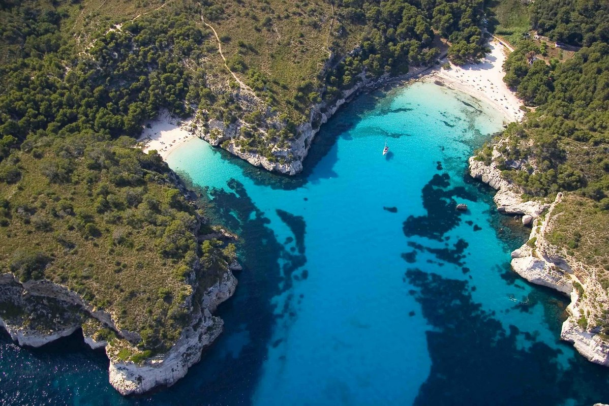 Where to find the clearest water on earth: Cala Macarelleta beach, Menorca, Spain, Google Images