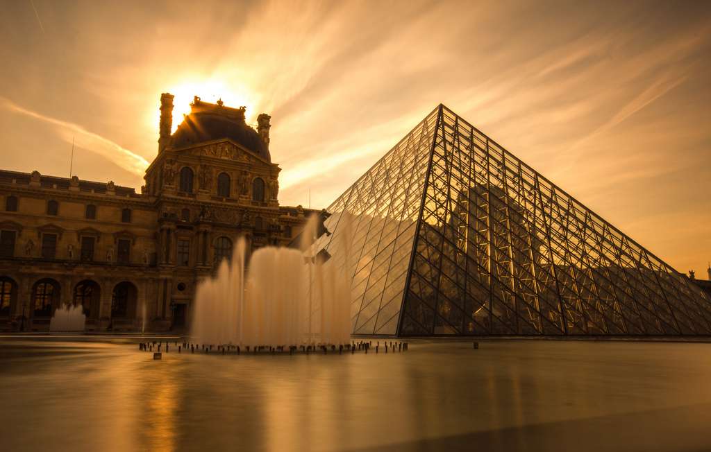 24 hours in Paris: The new Lourve pyramid stands in front of the stunning Lourve Palace. Photo by Graham MacKay, flickr