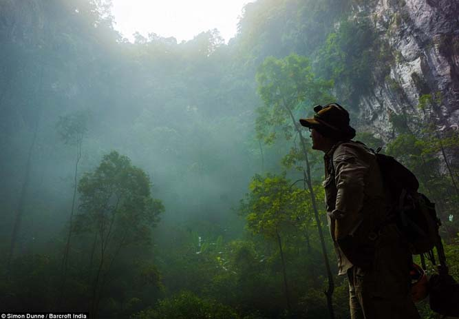 The skylight shows how great Son Doong Cave is inside the jungle. Photo by Simon Dunne
