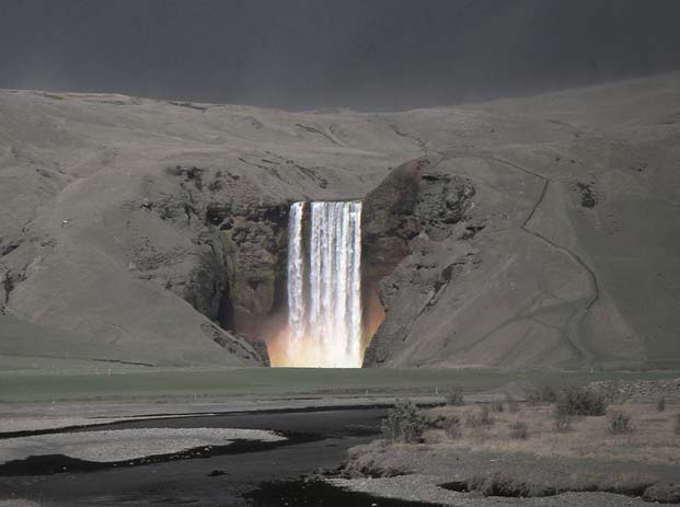 Skógafoss waterfall at night. Photo by Sverrir Thorolfsson, flickr