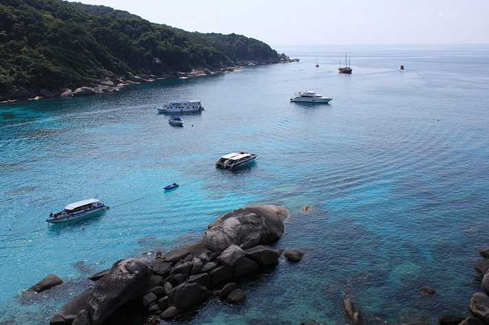 Incredible places to dive around the world: Liveaboard boats anchored in the Similan National Park. Photo by Alexander Ponick
