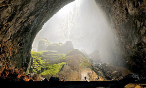 The silloutte of the person reveals how emense the Son Doong Cave is. Photo by National Geographic