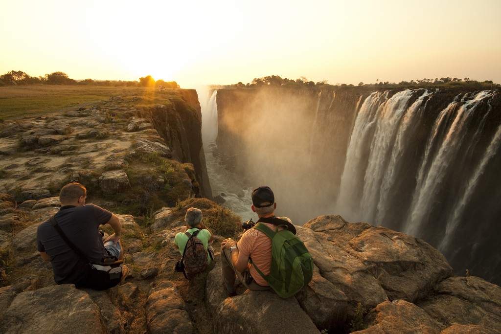 The best waterfalls: Travellers at the top of Victoria Falls. Photo by Michael Baynes Photography,  flickr