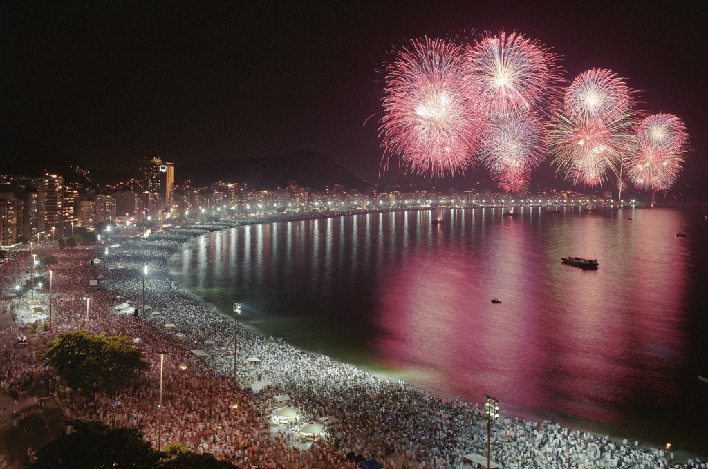 The best beach parties in the world: New Years fireworks display on Cochabana beach, Rio, Brazil. Photo by tqn.com