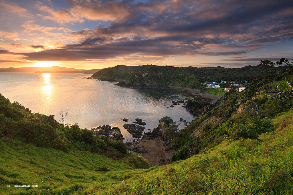 visit the Bay of Islands in New Zealand: Sunrise over the town of Russell. Photo by Chris Gin, flickr