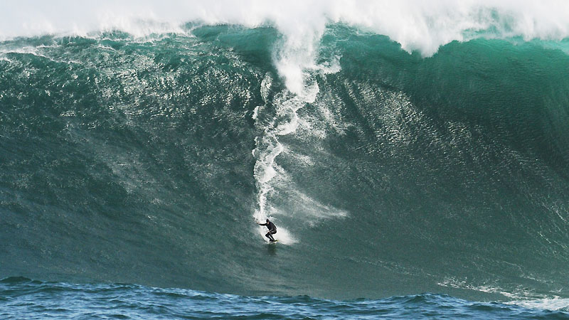 Best surfing in South Africa: Hitchin' a ride at the massive waves of Dungeons. Photo via blogspot