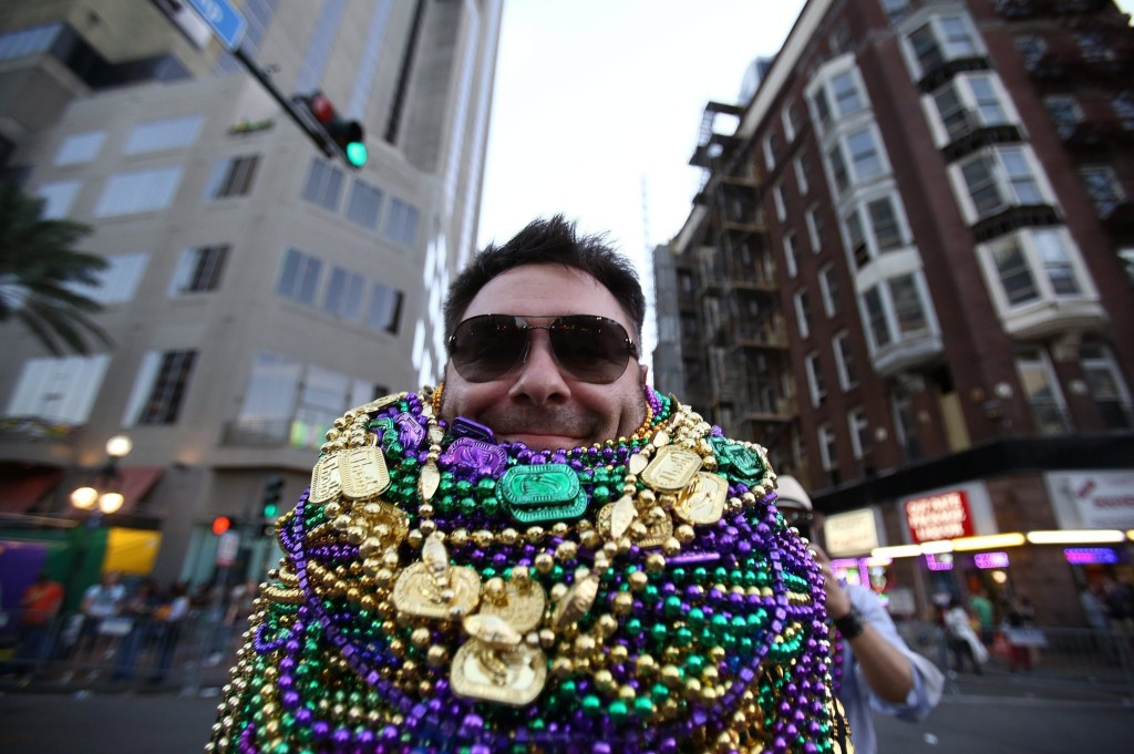 Guide on celebrating Mardi Gras in New Orleans: The aim is to catch as many throws as possible during the parades. Photo by trbimg.com