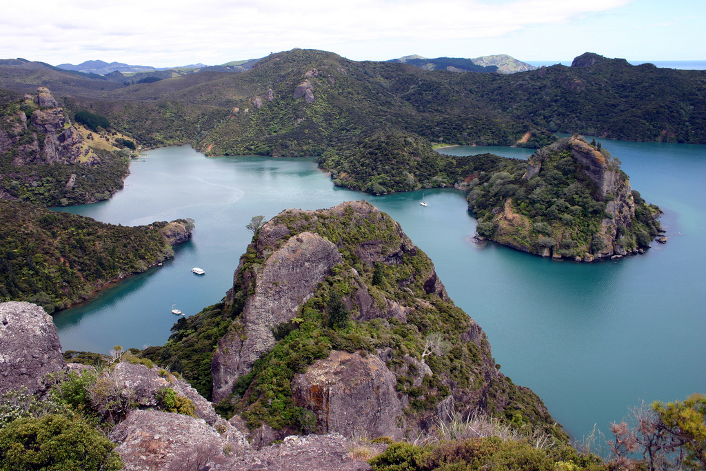 visit the Bay of Islands in New Zealand: The stunning Whangaroa Bay which is a great spot for water activities and hiking. Photo by Tonyfoster, flickr