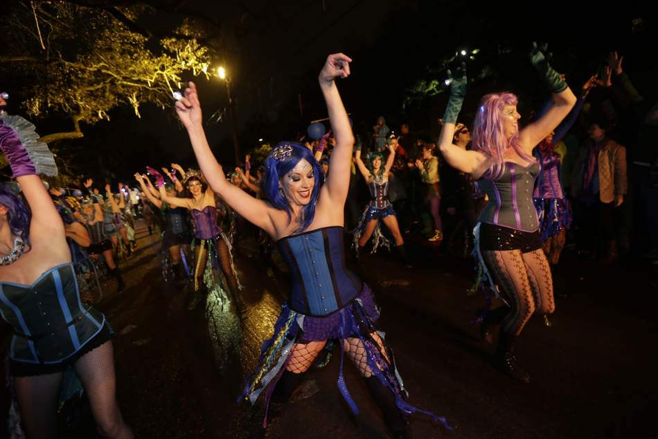 Guide on celebrating Mardi Gras in New Orleans: Members of the Mardi Gras dance group The Sirens perform during the Krewe of Orpheus Mardi Gras parade. Photo by Gerald Herbert