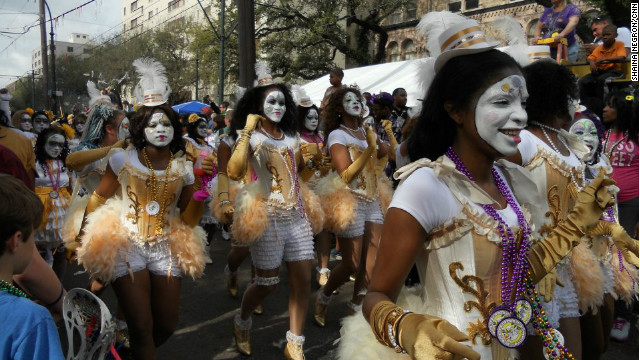 Guide on celebrating Mardi Gras in New Orleans: The New Orleans Baby Doll Ladies march in the Zulu parade. Photo by CNN
