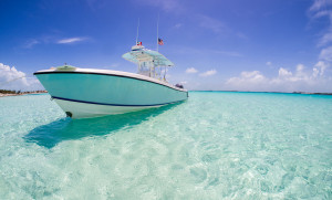 visit the Bahamas: A boat resting in the blue waters of the Bahamas. Photo by NormLanier, flickr