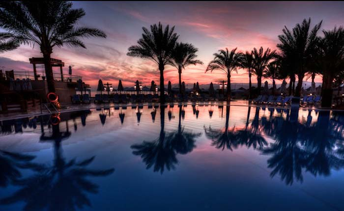 Sunset over pool at Intercontinental in Aqaba. Photo by Craig Corl, flickr