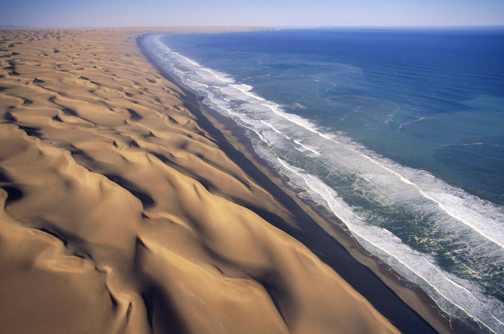 deserts in Namibia: The Atlantinc Ocean clashes with the desert of Namibia. Photo by nationalparktraveler.org