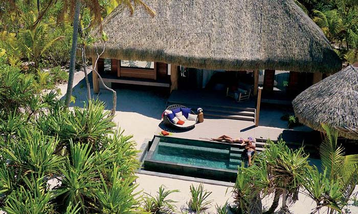 Relax in secluded Polynesian style at The Brando. Photo via thebrando.com