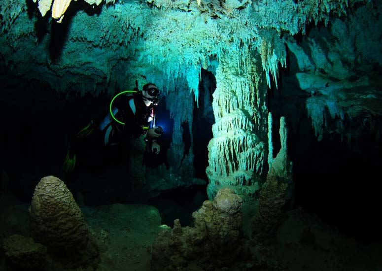 The flooded caves of Cenote Dos Ojos make for amazing snorkling. Photo by, David Alcaraz