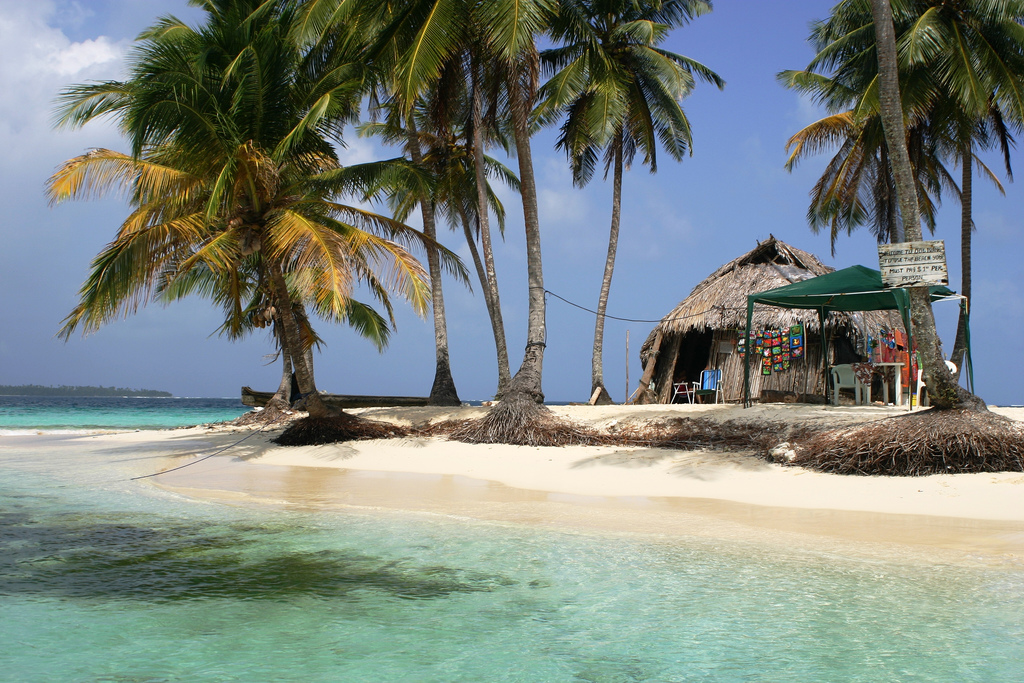 most secretive islands: Palm trees and a hut on the islands at San Blas. Photo by jollytempting, flickr