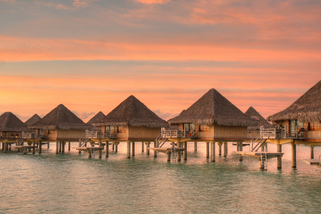 Bora Bora is famous for its overwater bungalows and stunning sun rises. Photo by SF Brit, Flickr