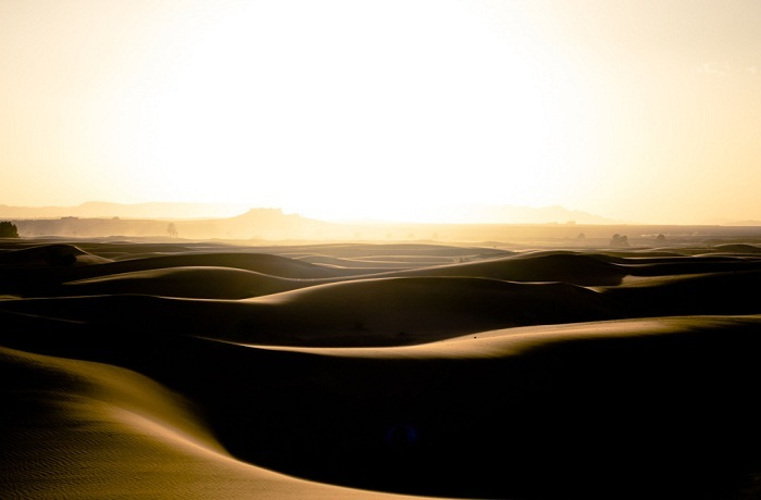 The Sahara Desert is a vast expanse of undulating sand dunes. Photo by hdeb89, Flickr