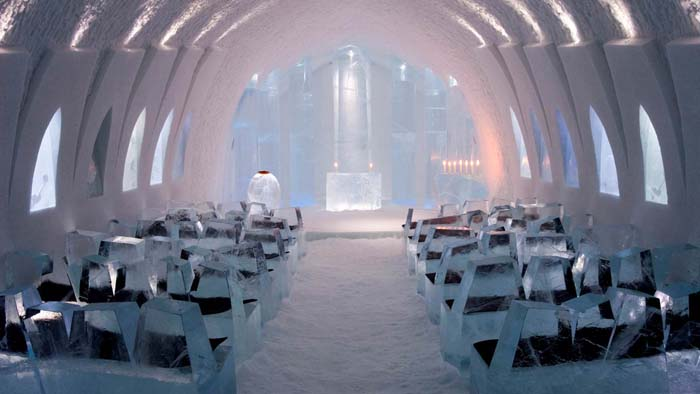 Walk down the aisle of the Ice Hotel church. Photo via carrier.co.uk.