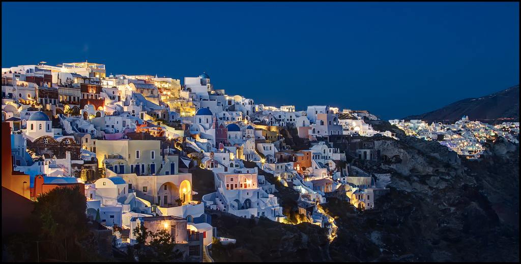 Best villages in Europe: The striking whitewashed walls and blue domed roofs of Oia in the Greek islands. Photo by Pedro Szekely, Flickr