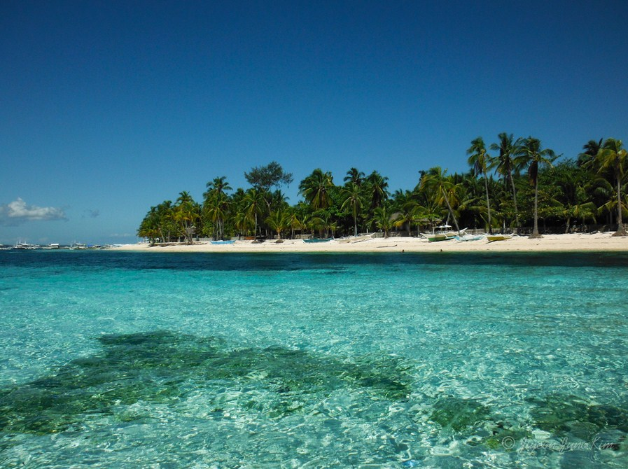lesser known islands in south-east asia: The waters of Malapascua Island. Photo by runawayjuno.com