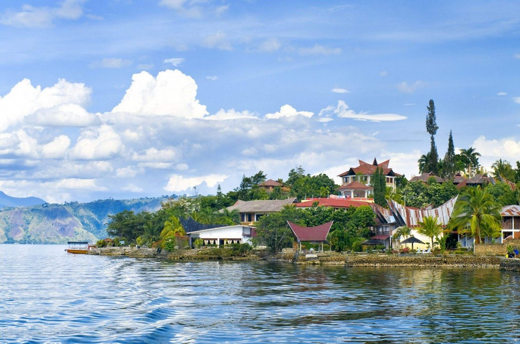 lesser known islands in south-east asia: The coastline of Lake Toba. Photo by Getintravel.com