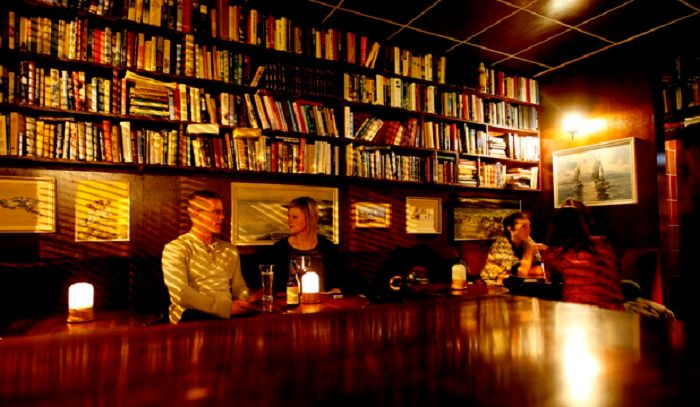 Have a cocktail and read a novel or two at the Library Bar. Photo by stuff.co.nz