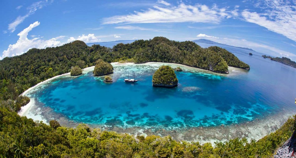 Incredible tropical waters and white sandy beaches in Raja Ampat. Photo by Elias Levy, Flickr