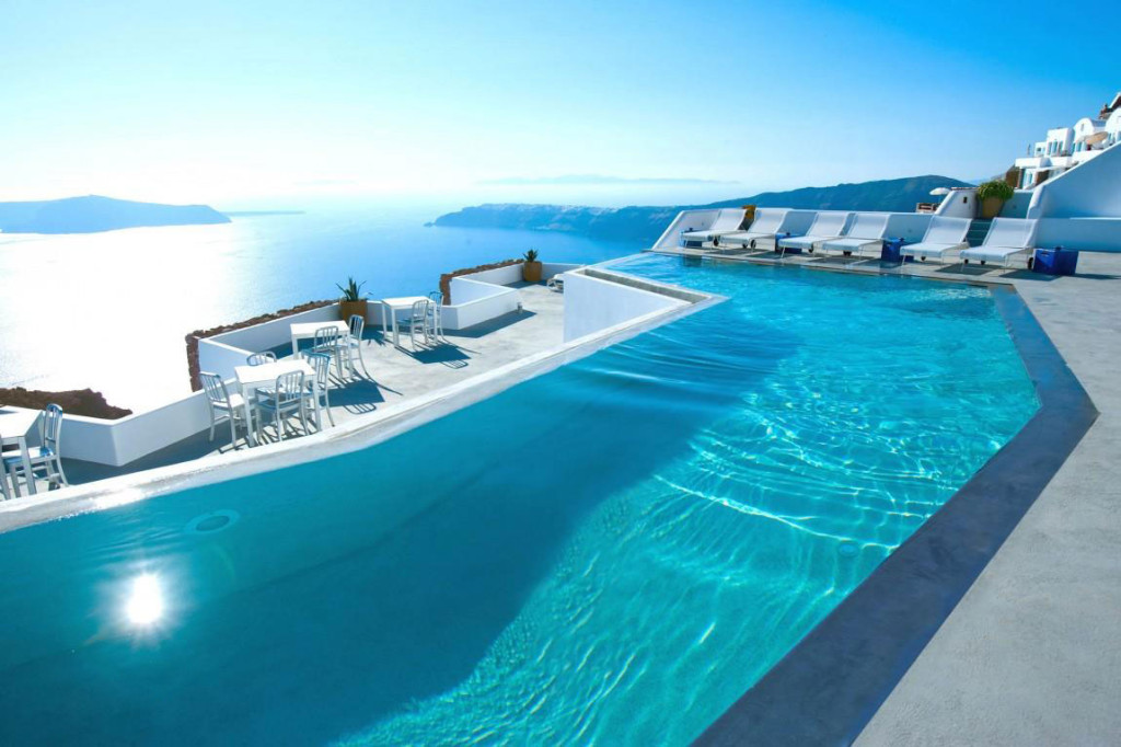 4 - The Katikies hotel pool in Santorini has iconic stone wrapped around the edges and breathtaking views of the Med. Photo via Luxury Homes