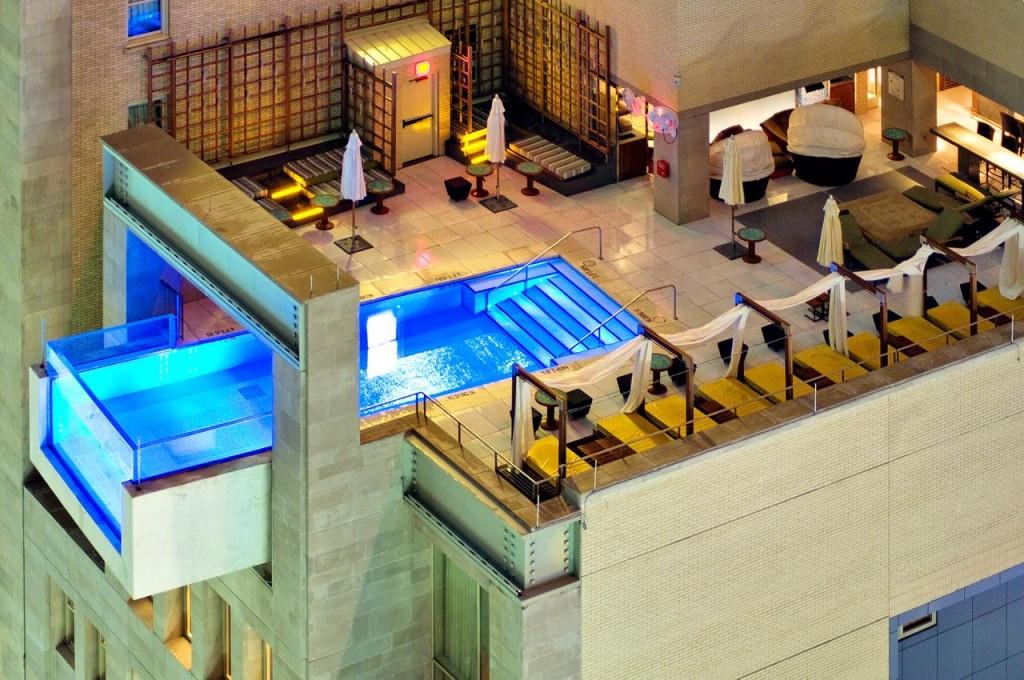 The pool at the Joule Hotel extends out over the city which gives excellent views of down town Dallas