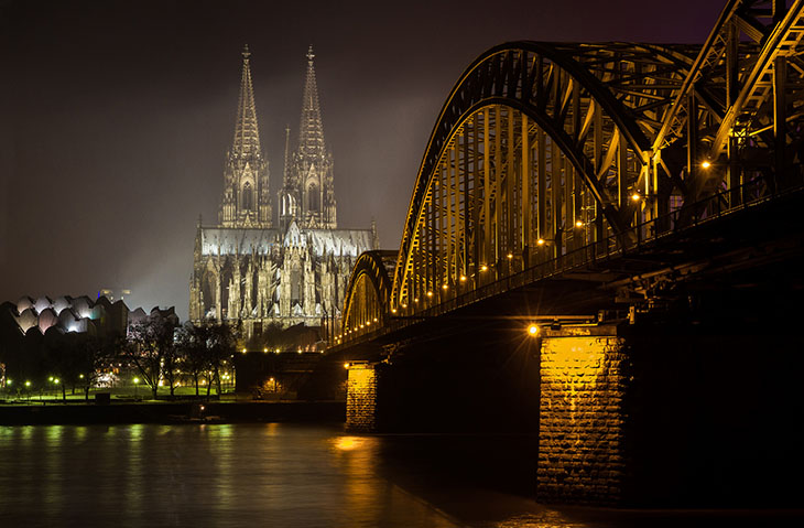The Cologne Cathedral showcased at night time in Germany. Photo by Jason Mrachina, flickr